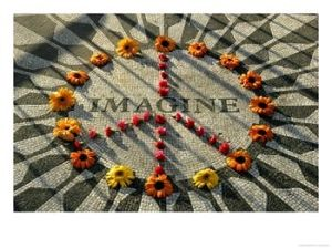 personaluse2_9050019~A-Makeshift-Peace-Sign-of-Flowers-Lies-on-Top-John-Lennon-s-Strawberry-Fields-Memorial-Posters